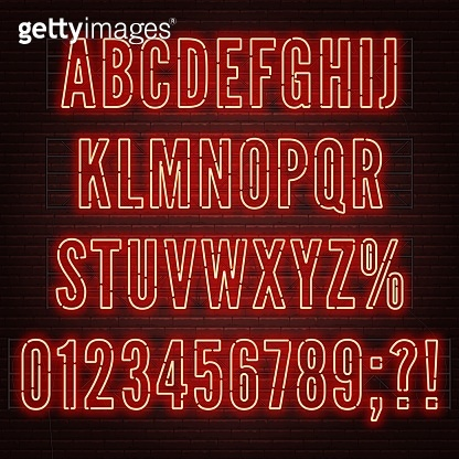 Retro red neon alphabet with numbers on brick wall background.