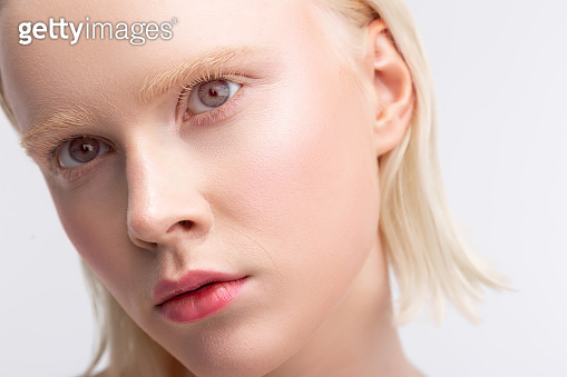 Beautiful young grey-eyed woman having light eyebrows