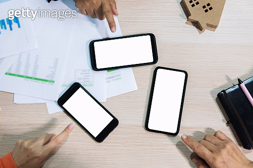 Business people hands using smart phone white screen on top view. Technology communication.