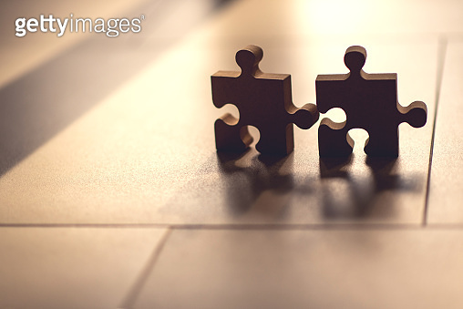 Closeup connecting jigsaw puzzle with sunlight effect, Business solutions, success and strategy concept.