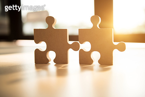 Connecting jigsaw puzzle with sunlight effect, Business solutions, success and strategy concept.