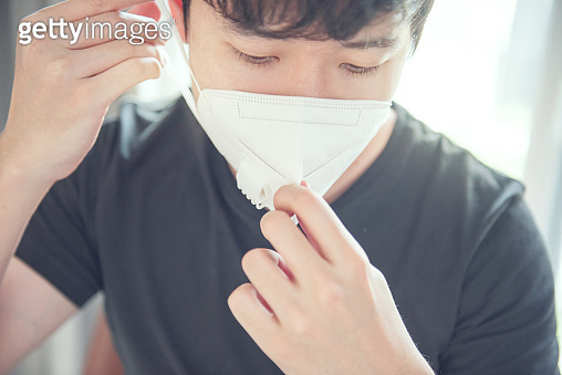Male wearing N95 Respiratory Protection Mask against air pollution. Healthcare concept