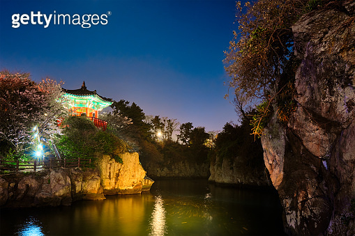 Yongyeon Pond with Yongyeon Pavilion illuminated at night, Jeju islands, South Korea