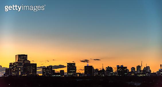 City skyline in dusk, colorful sky horizon