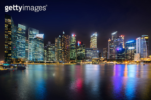 Singapore business district skyline financial downtown building with tourist sightseeing in night at Marina Bay, Singapore. Asian tourism, modern city life, or business finance and economy concept