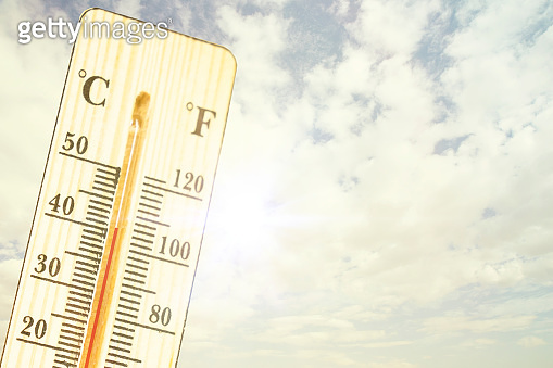 Thermometer in very hot day, high temperature or warm environment concept. thermometer in the sky, the heat