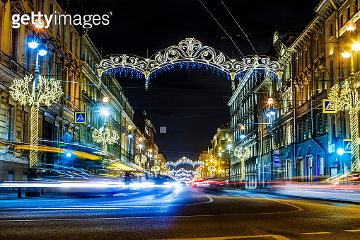 main street of the city of St. Petersburg Nevsky prospect, decorated with new year neon illumination with traces of car headlights, motion blur, city night landscape. St. Petersburg, Russia. Christmas decorations on Nevsky Prospect in St. Petersburg. New