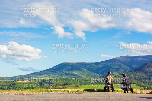 two motorcyclist on the road enjoying scenery