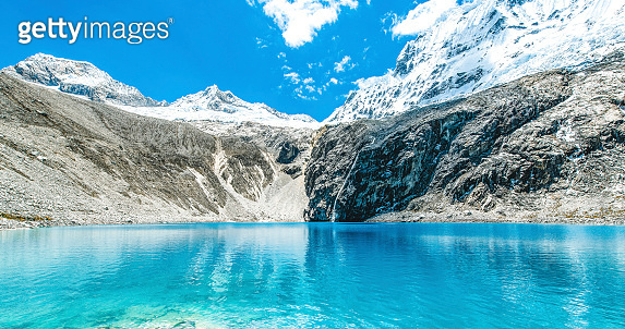 Snow melting in the Andes Mountains and falls down into a glacier lake