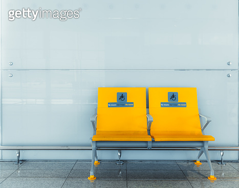Doubled yellow seats for disabled