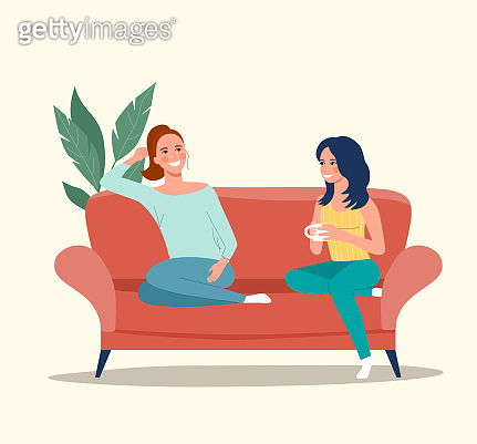 Girlfriends are sitting on the sofa. Vector flat style illustration