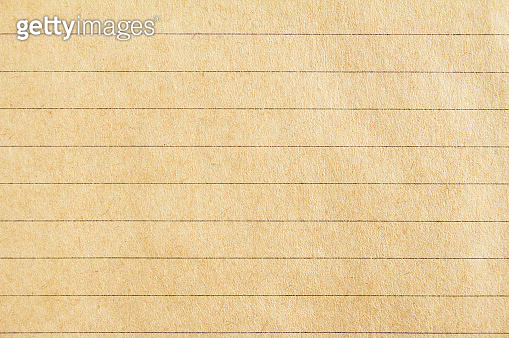 Closeup brown lined craft notebook paper texture background.