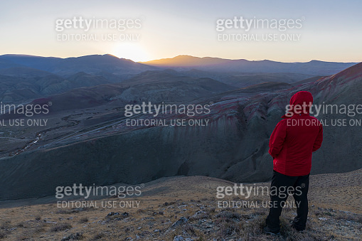 Hiker watching the sunset in the mountains