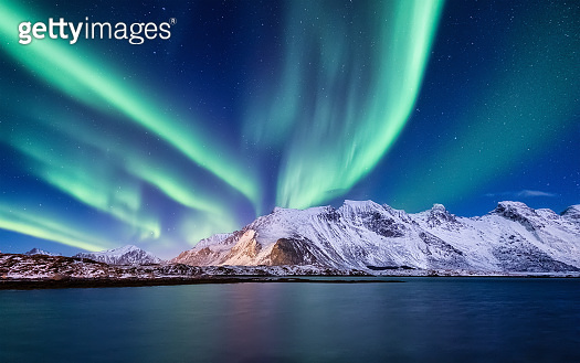 Aurora Borealis, Lofoten islands, Norway. Nothen light, mountains and ocean. Winter landscape at the night time. Norway travel - image