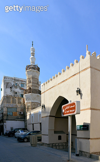 Al Shafei mosque seen from Suq Al Jami - Al Mazloum, Al Balad district, Historic Jeddah, Saudi Arabia - UNESCO world heritage site