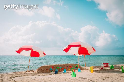 kid toys on tropical sand beach vacation