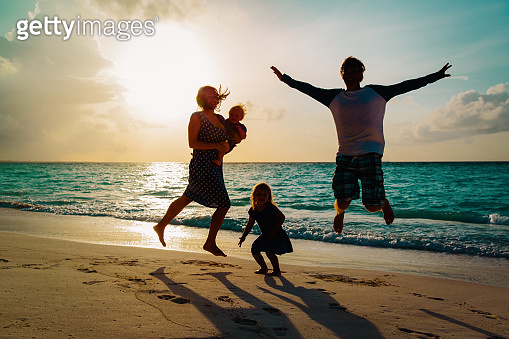 happy family with kids on enjoy vacation, play on sunset beach