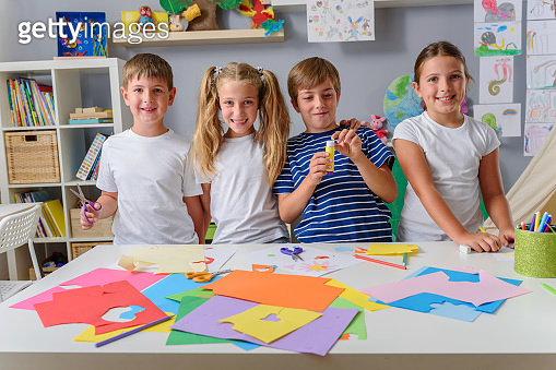 Creative kids making some paper arts and crafts