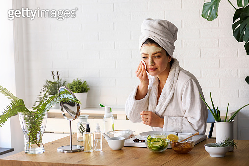 Woman at home having skin care routine
