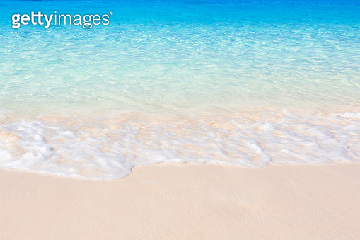 Pure white sand beach and turquoise seawater on sunny summer.