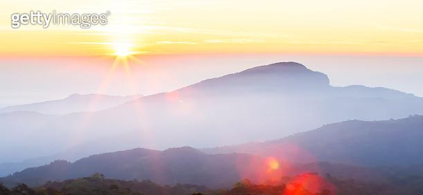 Wonderful sunrise over the mountain peak.