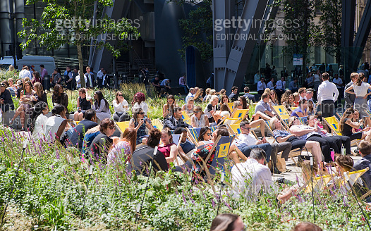 Business people and office workers having a lunch on the square next to the Lloyds building  in the City of London