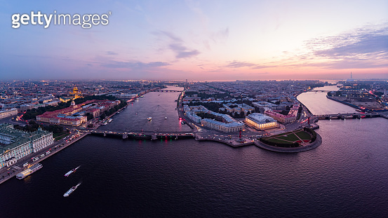 Beautiful aerial evning view in the white nights of St. Petersburg, Russia, The Vasilievskiy Island at sunset, Rostral Columns, Admiralty, Palace Bridge, Stock Exchange Building. shot from drone.