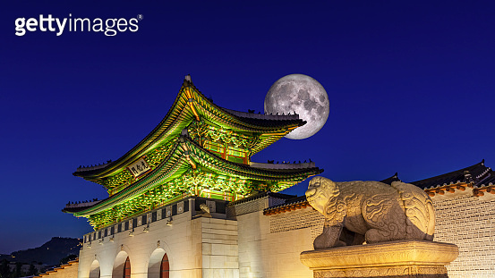 Gyeongbokgung palace at night with Full moon in Seoul South Korea