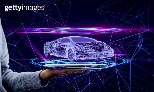 Hand with phone and car hologram