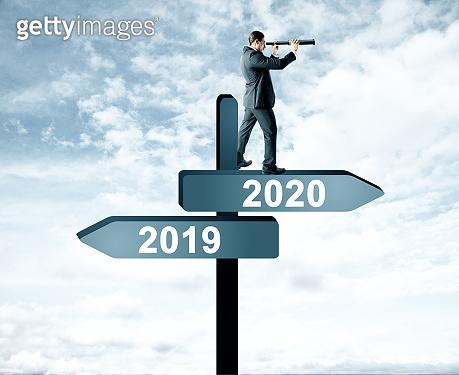 Man on 2019, 2020 sign