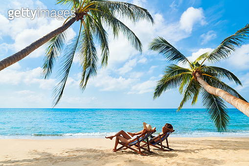 Couple relax on the beach enjoying beautiful sea on the tropical island