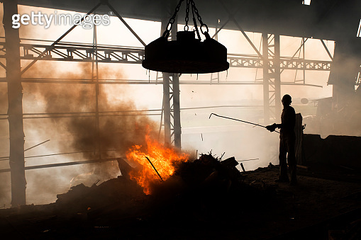 Workers melt metal scraps in the furnace of a steel mill to produce rods in Demra, Dhaka, Bangladesh.