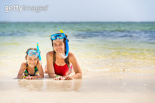 Young mother and little daughter enjoying the beach in Dominican Republic