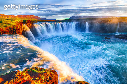 Dramatic sunset view  of waterfall in Iceland