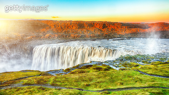Dramatic sunset view of fantastic waterfall in Iceland
