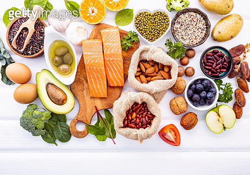 Ingredients for the healthy foods selection on white background. Balanced healthy ingredients of unsaturated fats and fiber for the heart and blood vessels.