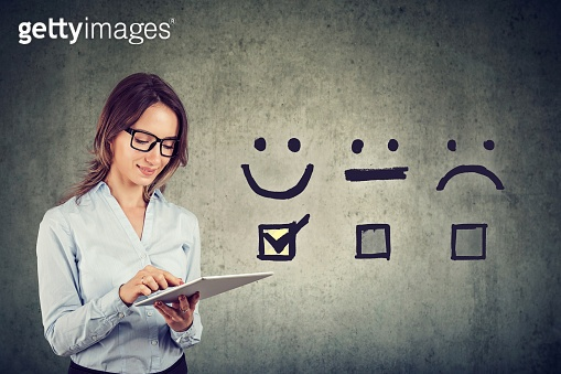 Happy business woman giving excellent rating for online satisfaction survey
