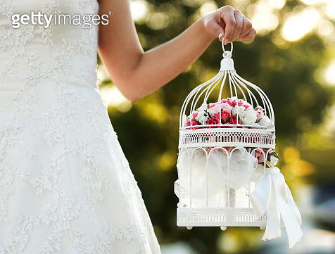 White cage with flower