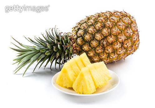 Slice of pineapple on white dish
