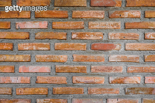old orange rough brick wall for background