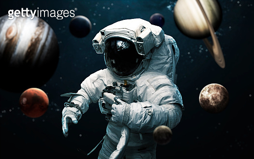 Astronaut and all planets of Solar system. Science fiction art. Elements of this image furnished by NASA