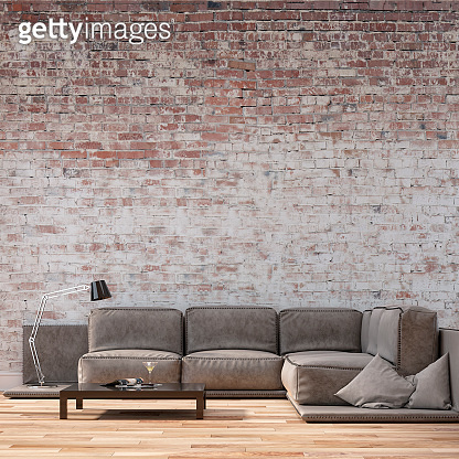 Empty living room with sofa - ruined brick wall