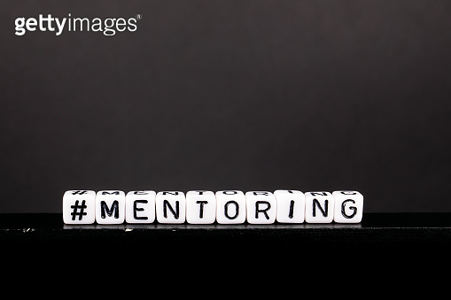 Hashtag with word Mentoring. Skills and education background