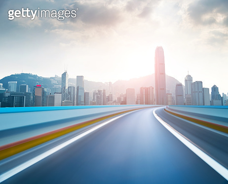 Hong Kong skyline and blurred motion road