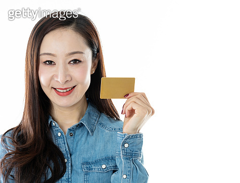 Woman holding credit card on white background