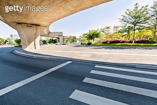 Zebra crossing below elevated road