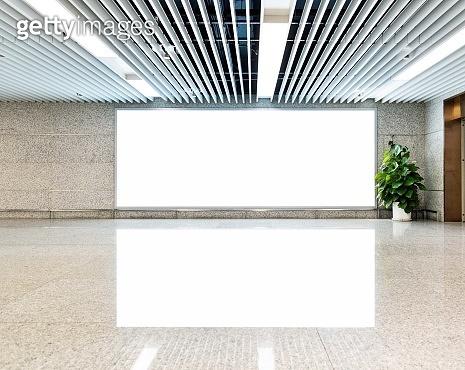 Blank billboard on the corridor of airport