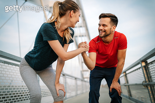Beautiful couple running in nature living healthy