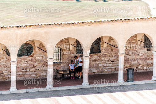Town or village city in Umbria with church arches path high angle view