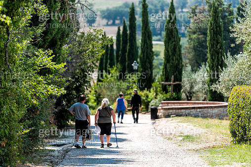 Village city in Umbria with road path near San Damiano church during sunny summer